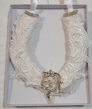 BBHS24 white satin bridal horseshoe with pearls and light ivory lace embellishments.