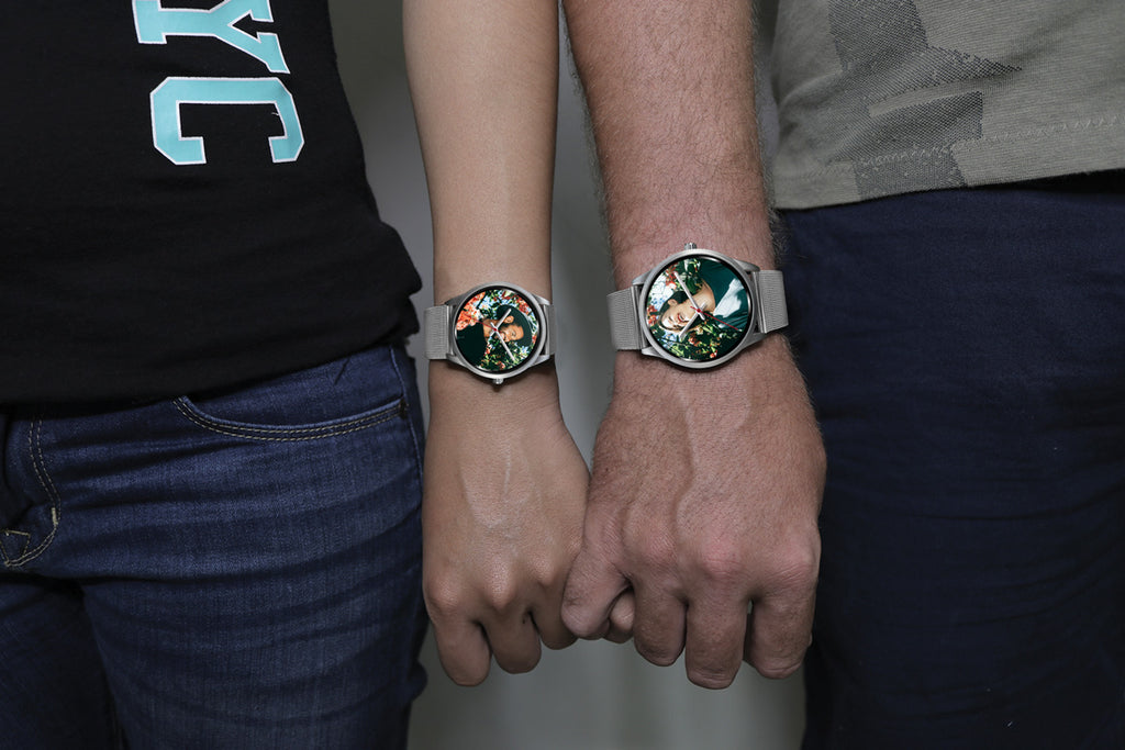 Silver watch worn by couple