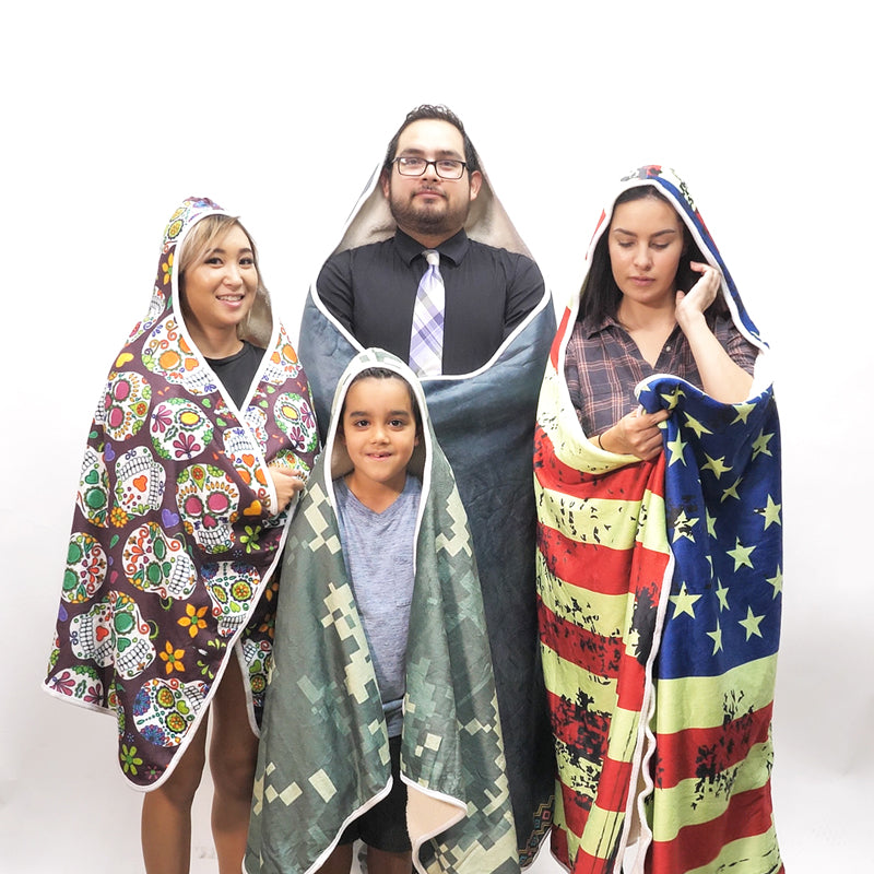 Different people wearing hooded blankets