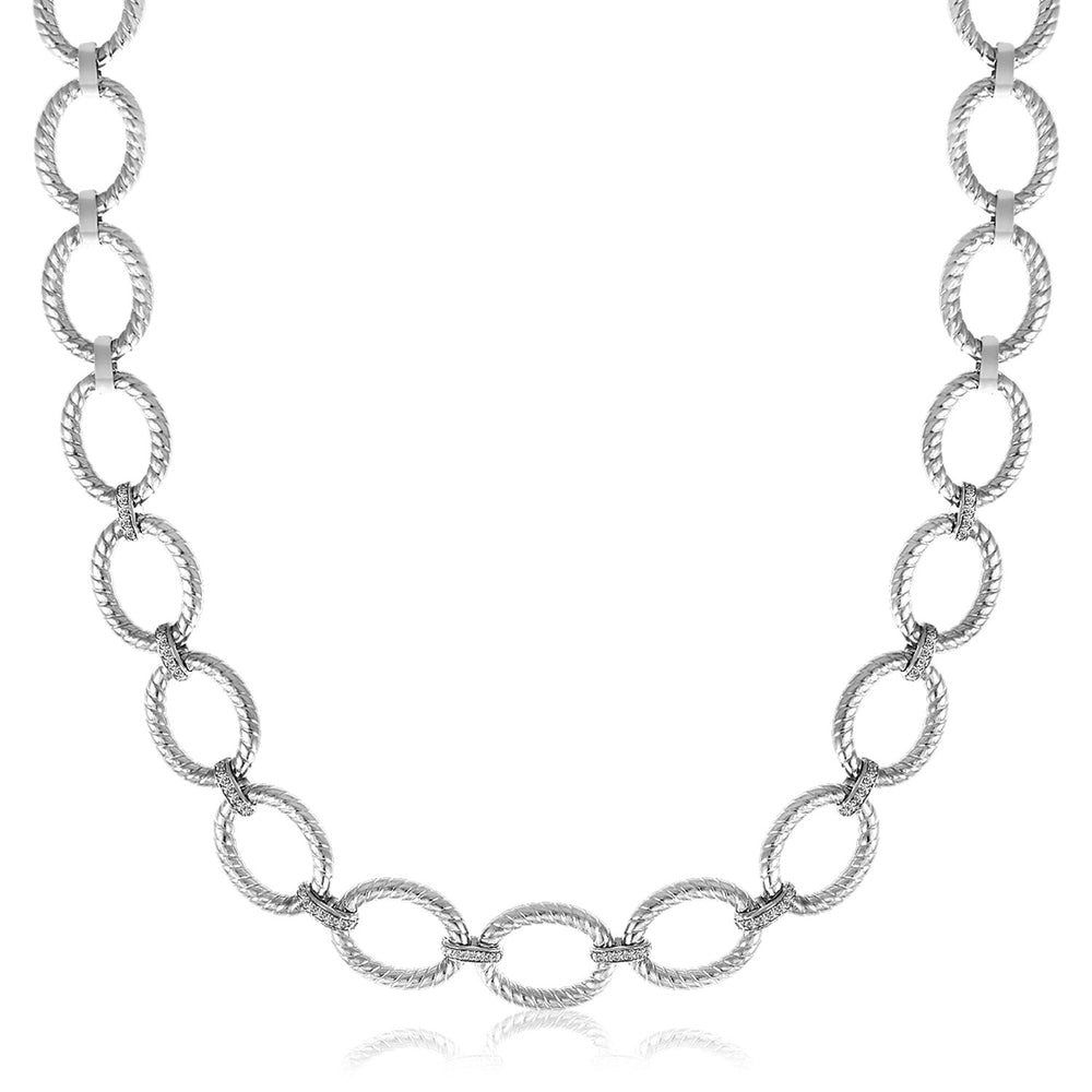 Sterling Silver Rhodium Plated Diamond Accented Rope Oval Necklace (.26cttw)
