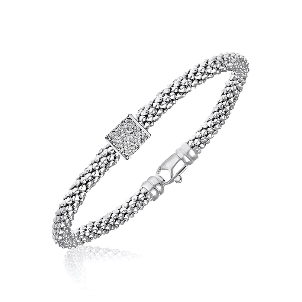 Sterling Silver Rhodium Plated Diamond Embellished Popcorn Bangle (.13cttw)