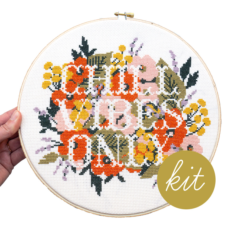 text reads Chill Vibes Only, pink, yellow, orange, and purple flowers with two tone green leaves, DIY cross stitch kit