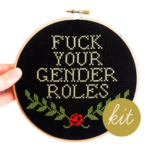 Load image into Gallery viewer, Fuck Your Gender Roles text on black aida cloth with red rose and green leaves, DIY cross stitch kit