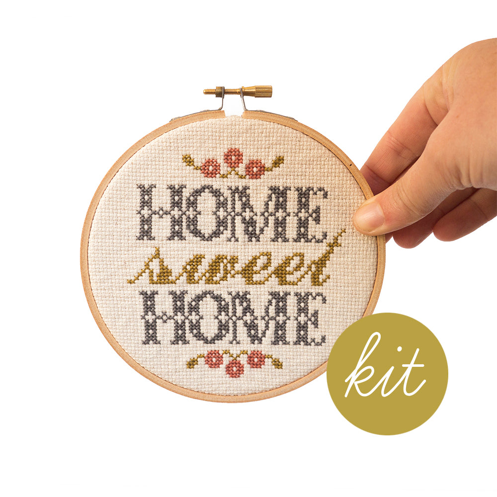 traditional grey and gold text reads Home Sweet Home with pink and gold flowers, DIY cross stitch kit