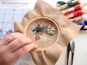 in progress cross stitch kit with handmade floral needle minder, embroidery floss and scissors