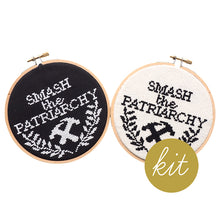 Load image into Gallery viewer, smash the patriarchy with leaves and two crossed hammers stitched on black and cream aida, DIY cross stitch kit