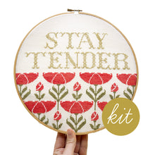 Load image into Gallery viewer, metallic gold text reads Stay Tender with art nouveau red poppies and green leaves underneath, DIY cross stitch kit