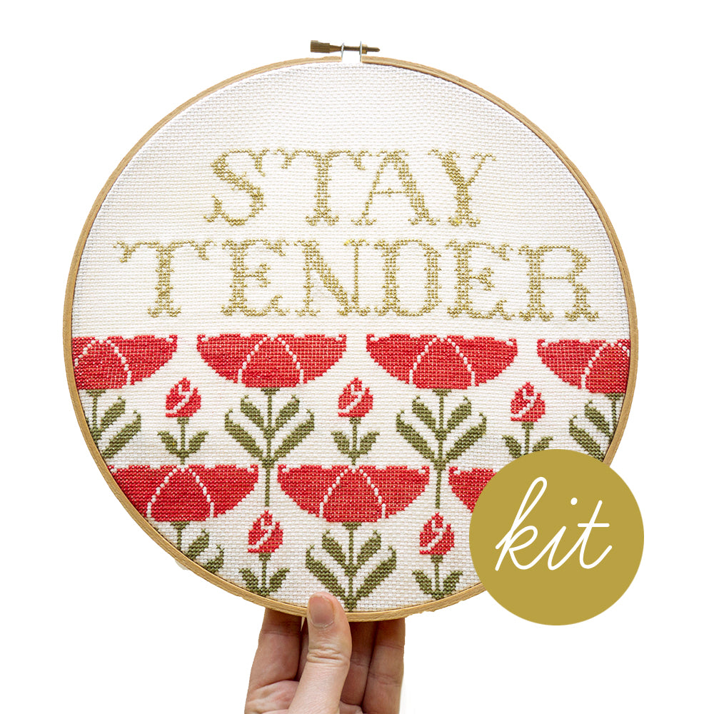 metallic gold text reads Stay Tender with art nouveau red poppies and green leaves underneath, DIY cross stitch kit