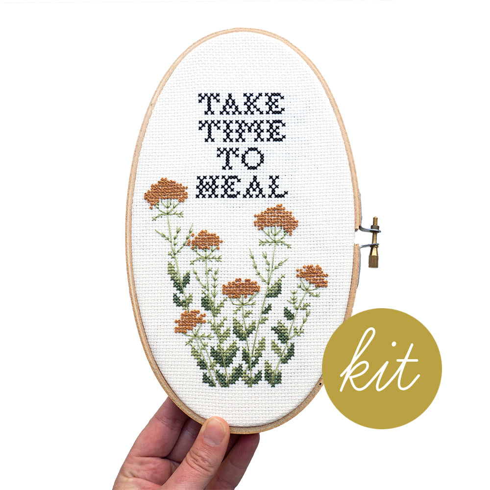 take time to heal text in traditional cross stitch font with french knot yarrow flowers, DIY cross stitch kit