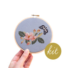 Load image into Gallery viewer, pink wild rose with black moth stitched on blue aida cloth, DIY cross stitch kit