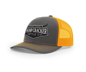 Charcoal and neon mesh trucker hat with the full Cattle Co. logo embroidered on the front from Swamp Cracker Outdoor Apparel.
