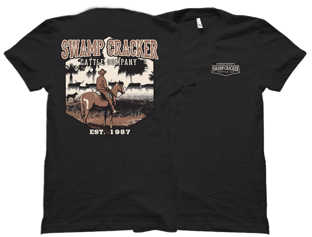 Front and back of the black Cattle Co. outdoorsman shirt with a cowboy on the back from Swamp Cracker Outdoor apparel.