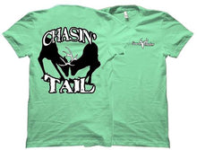 "Mint colored tee shirt with two bucks locking horns on the front surrounded by the words ""Chasin' Tail."""