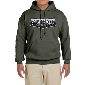 The Swamp Cracker Cattle Co. pullover hoodie being worn by someone. The front has the Swamp Cracker Cattle Co. emblem.