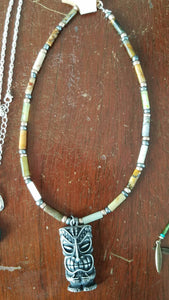 Earth toned choker necklace with statue charm