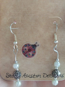 Ivory and silver rose bud earrings