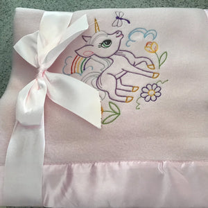 Light pink satin lined fleece rainbow and unicorn baby blanket
