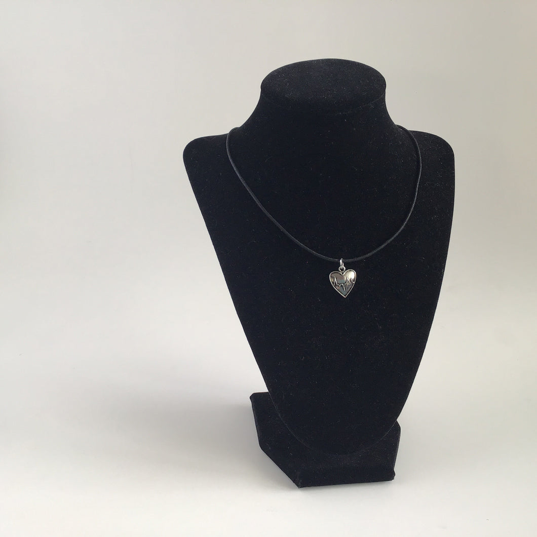 Silver heartbeat image locket necklace on black cord