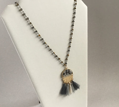 Unique gray and white tassel pendant necklace with gold and bead accents