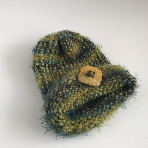 Fuzzy multicolored hat with button charm