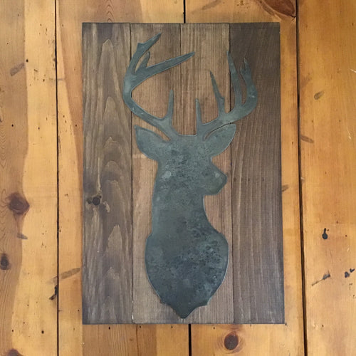 Deer sign, metal on wood