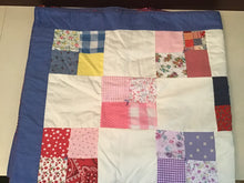 Handmade quilted blanket in a variety of colors and prints