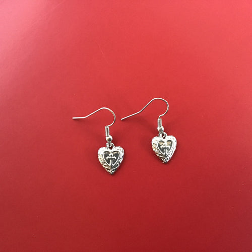 Silver cross-in-heart earrings