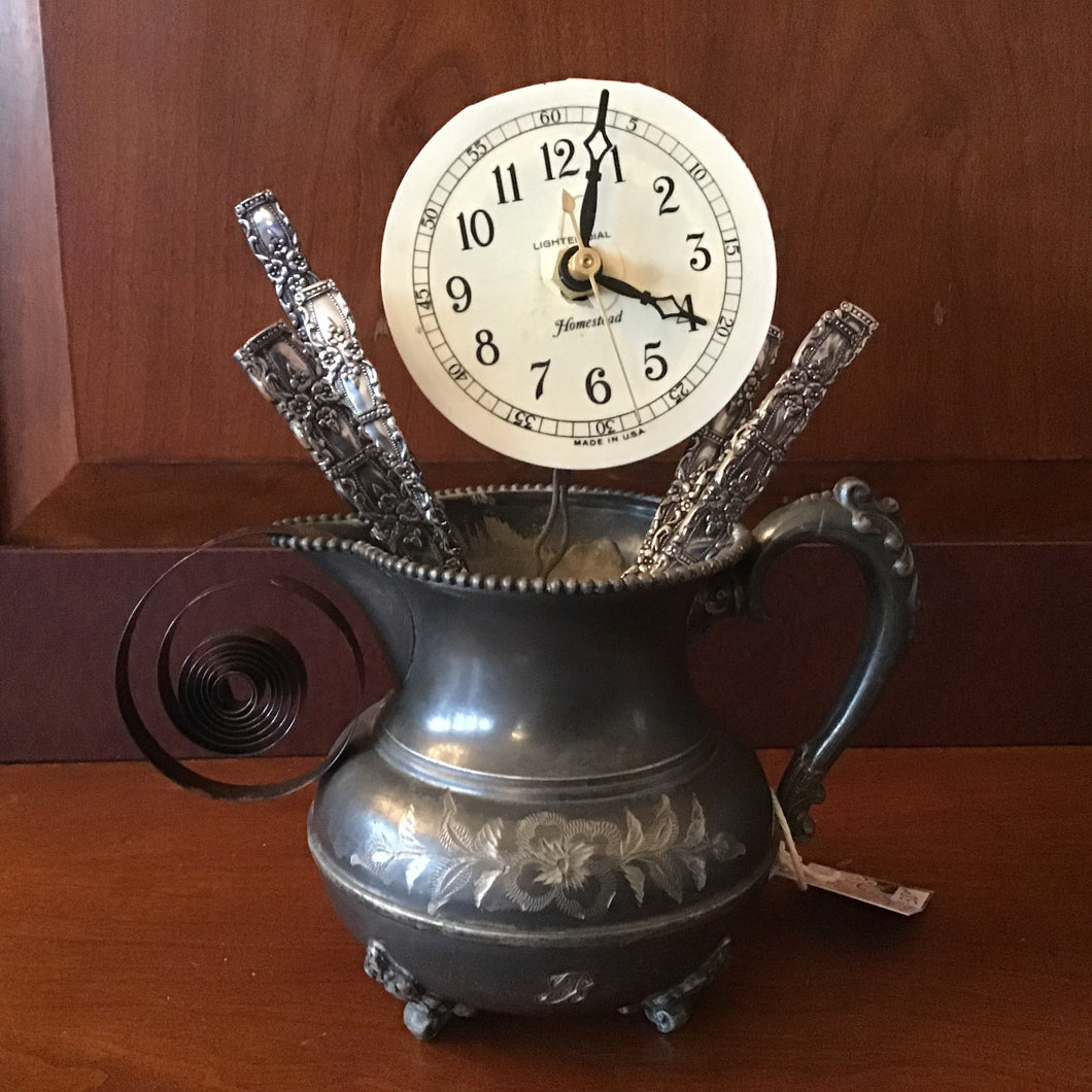 Exploding clock in a pewter tea cup - it really works!
