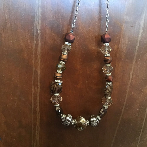 Amber and brown multi design beaded necklace