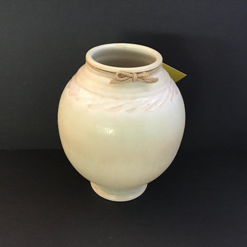 Light yellow-green vase with pale peach etching