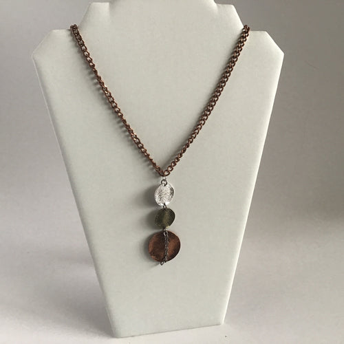 Stacked disc pendant necklace in multi tone hammered metals