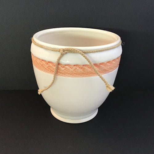 Cream colored porcelain vase with orange etching
