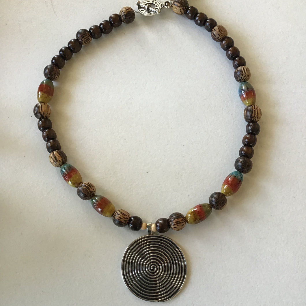 Spotted Wood Bead Necklace with Spiral Circle Pendant