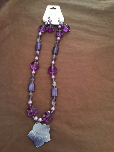 Purple beads and floral pendant