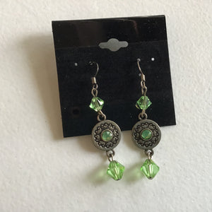 Green dangle earrings with flower design