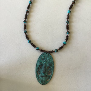 Turquoise mask with earth tone beads, long necklace