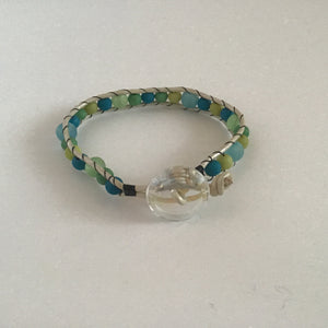 Blue and green wrap bracelet with clear button clasp