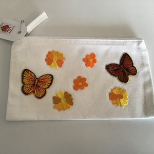 Embroidered yellow butterfly and daisy cosmetics bag