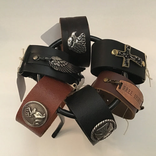 Men's wide leather wrap cuffs with metal insignia