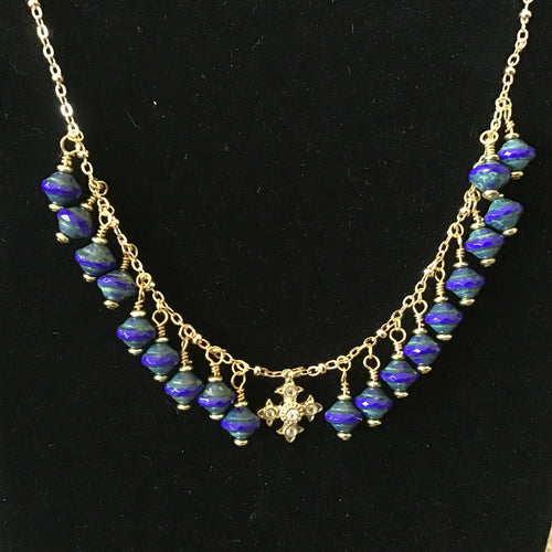 Blue beads with gold cross pendant necklace
