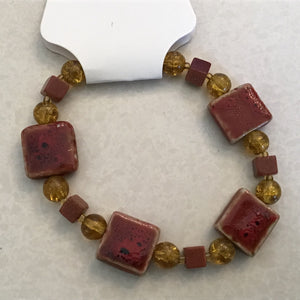 Brick and yellow beaded bracelet