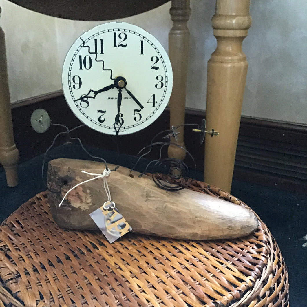 Whimsical wooden shoe clock