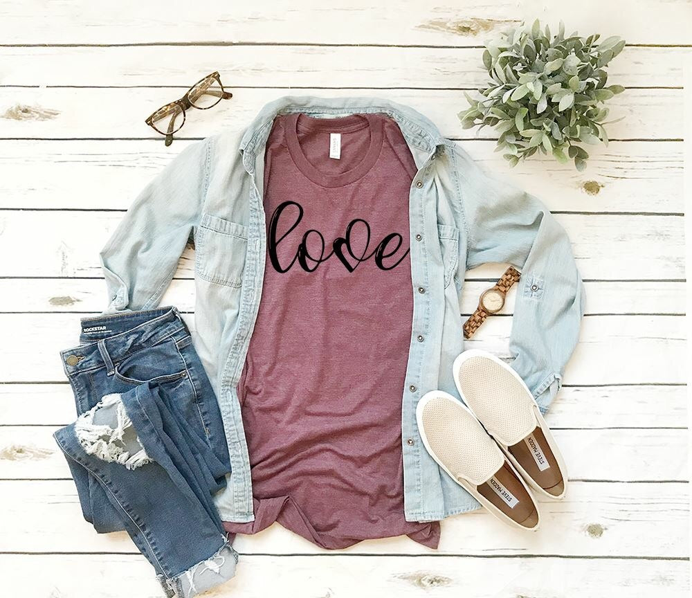 "A t-shirt with the word ""Love"" written on it and the V is replaced with a heart"