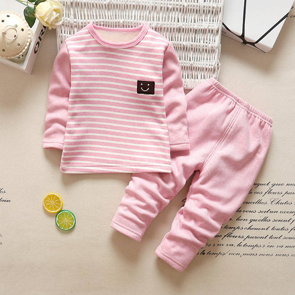 Pink baby girl clothing set made of cotton that comes with a t-shirt with a smile label and pants.