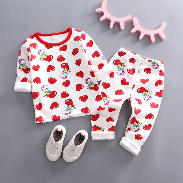 Red baby girl clothing set made of cotton that comes with a  t-shirt and pants with heart pattern. In some hearths there are a little bear girl  sitting on them