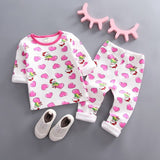 Pink baby girl clothing set made of cotton that comes with a  t-shirt and pants with heart pattern. In some hearths there are a little bear girl  sitting on them