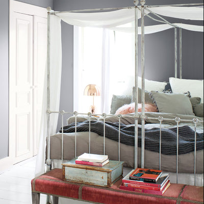 Benjamin Moore's 2118-50 Excalibur Gray in a bedroom. Shop gray/blue paint tones from 2018 color trends.