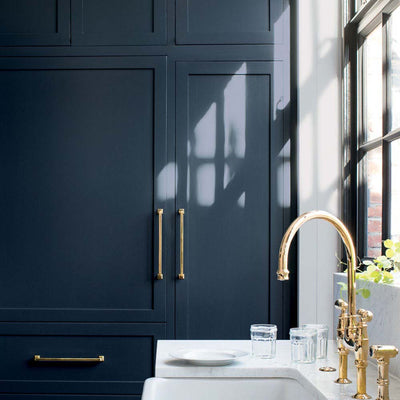 Benjamin Moore's HC-154 Hale Navy on kitchen cabinets.