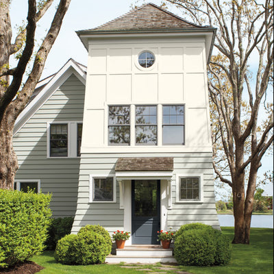 Benjamin Moore's OC-69 White Opulence on exterior of house. Shop soft white paint colors from 2018 color trends.