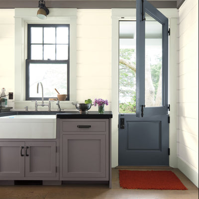 Benjamin Moore's 2112-40 Stone a warm gray on kitchen cabinets. Shop warm gray paint colors from 2018 color trends.